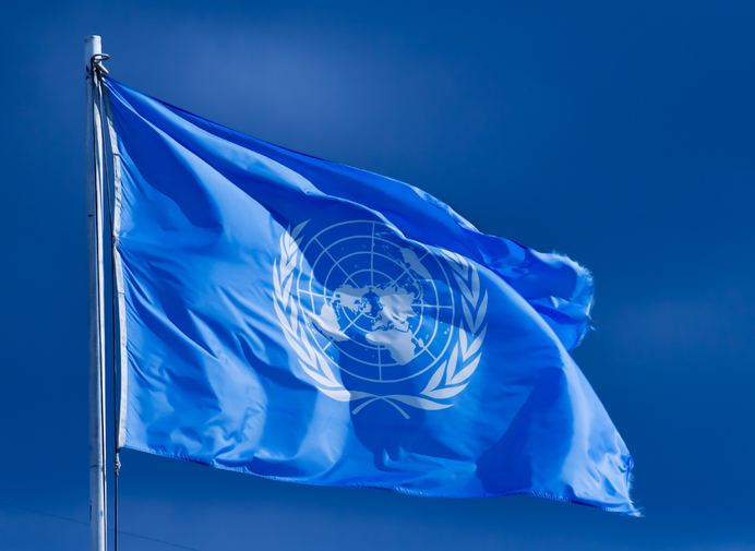 Pristina, Serbia - February 2, 2007: United Nations flag. The United Nations (UN) is an international organization whose stated aims are facilitating cooperation in international law, international security, economic development, social progress, human rights, and achievement of world peace.